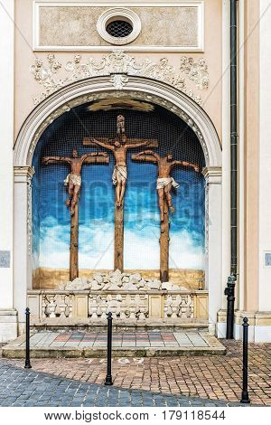 The 18th century sculpture of Golgotha on the south-side wall of the Church of the Visitation of the Blessed Virgin Mary, the city's first Carmelite Church.
