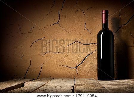 Bottle of cabernet in cellar near clay wall