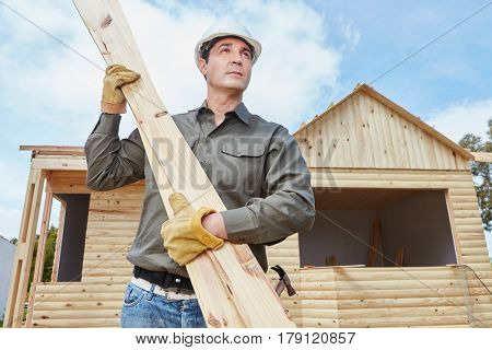 Handyman building vacation woodhouse as DIY project