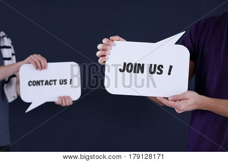 Two people holding 'Contact us' and 'Join us' speech bubbles