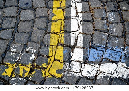 Marks for parking place on the street made of cobblestones