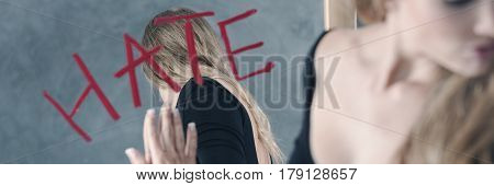 Girl Shifting Away From Mirror