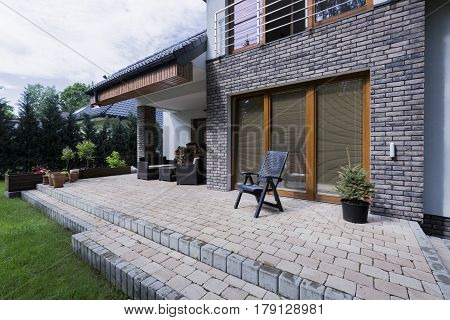 Small Concrete Terrace With Furnitures