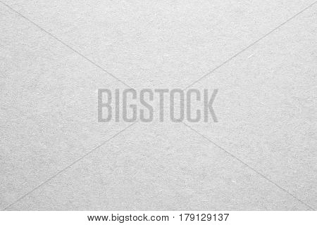 Blank sheet of paper or plywood in white color. Rough surface of background. Concept of recycling raw materials. Natural paper background texture for your design. Rustic, vintage style. Horizontal.