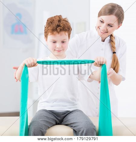 Boy Exercising With Elastic Band