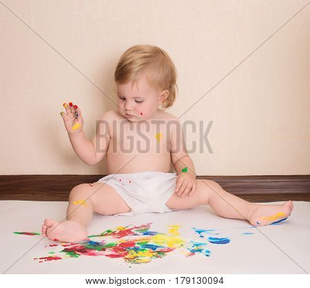 Baby drawing with her fingers. Toddler painting.