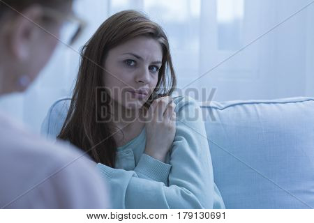 Anxious Woman Talking With Psychologist