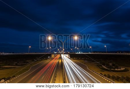 Light trails from cars moving fast late in the evening on a motorway of Nicosia Cyprus. Concept of high speed.