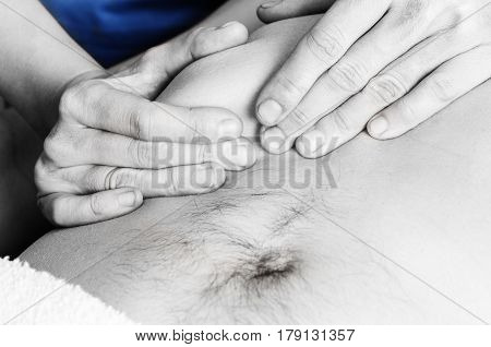 Physiotherapist Is Doing An Activation Of The Diaphragm. Massage To A Man Patient In Silhouette Stud