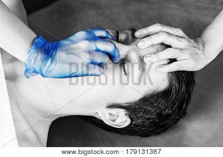 Physiotheraphist Doing A Sinus Massage, Theraphy In Silhouette Studio On White Background