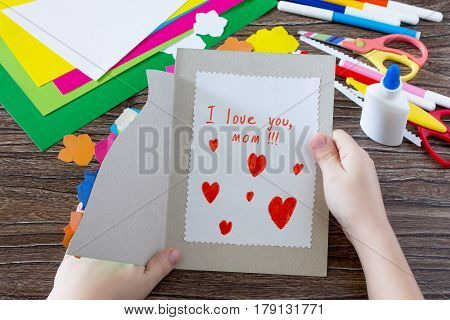 Children's Gift. Postcard Dress With Flowers On The Day Of Matter Inscription That I Love You. Child