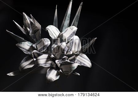 bouquet of origami flowers from money. Banknotes