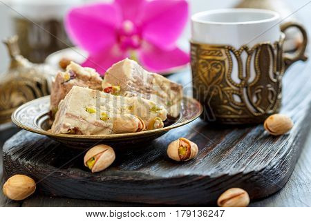 Tahini Halva With Pistachios On A Bronze Plate.