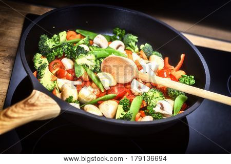 Healthy cooking concept with fresh vegetables in sauce pan. Food background