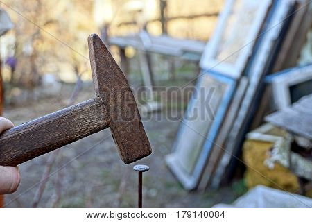 Clogging with a rusty old nail hammer