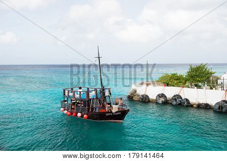 Cozumel Mexico - December 24 2015: men yachtsmen on touristic boat yacht on sea ocean blue water near bay harbor outdoor on cloudy sky background. traveling and vacation sport and sailing