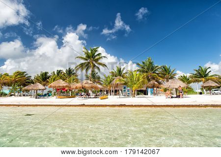 Beach At Sea Water, Green Palms, Umbrellas, Costa Maya, Mexico