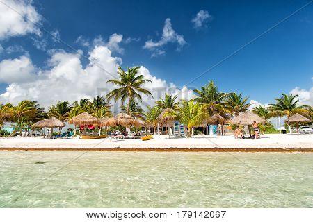 Beach At Sea Water, Green Palms, Umbrellas, Costa Maya, Mexico