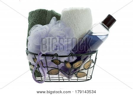 isolated assorted bath products on white in a metal basket