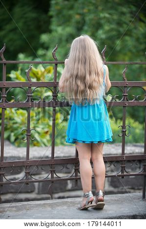 Small Baby Girl In Blue Dress Outdoor