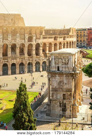 ROME, ITALY - OCTOBER 1, 2012: Colosseum (Coliseum) and Arch of Constantine.
