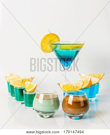 Colorful Drink In A Martini Glass, Blue And Green Combination, Ten Drinks In A Shotglass, Drinks Set