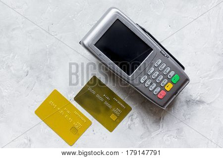 purchase payment with credit card through terminal on stone table background top view