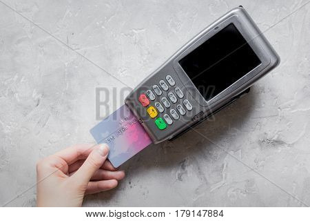 purchase payment with credit card through terminal on stone table background top view mock-up