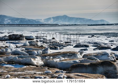 Ice cover on the Sea of Okhotsk against the background of mountains Magadan region