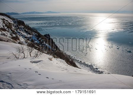 The sun is reflected in the Sea of Okhotsk Magadan region