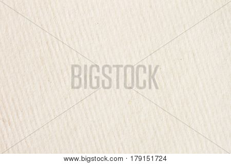 Texture of cream-coloured pastel in a diagonally strip paper with small inclusions for watercolor and artwork. Modern background, backdrop, substrate, composition use with copy space