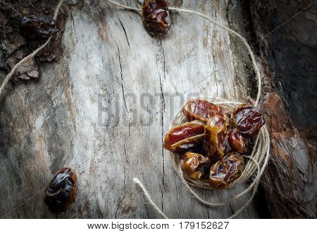 Dried Dates With Twine On Aged Timber