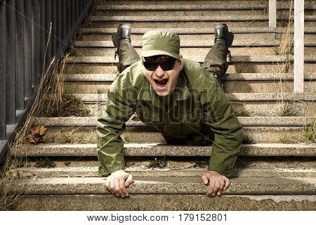 Soldier on sentry duty with no respect making fun on stairs