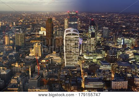 Day to night elevated view of the financial district of London, England.