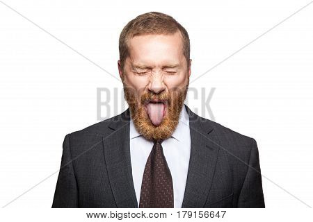 Crazy businessman with clossed eyes and tongue. isolated on white looking at camera.