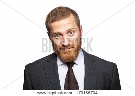 Unhappy dissatisfied businessman. isolated on white looking at camera.