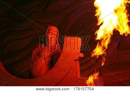 Arabian Woman - Sand Sculpture Lit By Fire Flames At Night