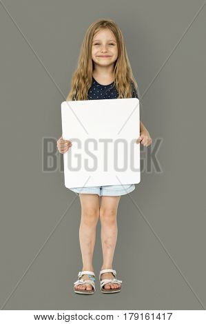 Little girl smiling and holding blank placard poster