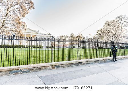 Washington DC, USA - March 4, 2017: White house with secret service police man protecting with fence