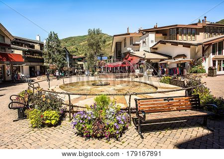 Vail, USA - September 10, 2015: Fountain at a square on Bridge Street in Vail Colorado with benches