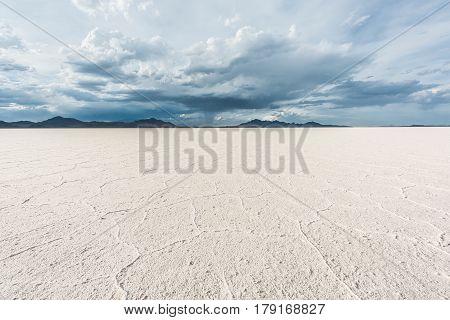 White Bonneville Salt Flats landscape with rain storm clouds in distance