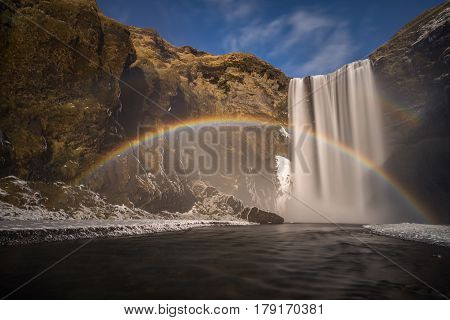 Rainbow at Skogafoss waterfal in winter Iceland