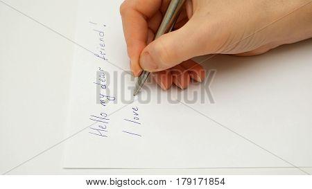 Female hand writes