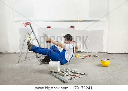 Construction Worker Falling down the Ladder