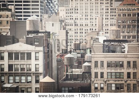 Water towers on rooftops skyline of New York City,  northern view, filter effect