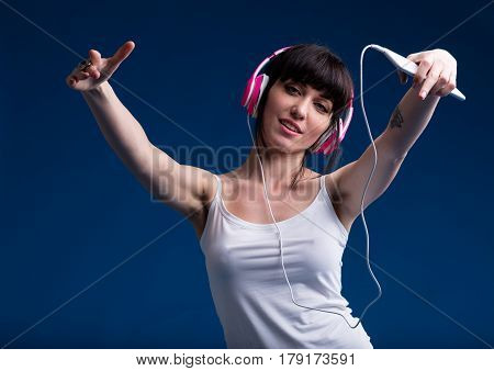 Young Woman In Underwear Listening To Music
