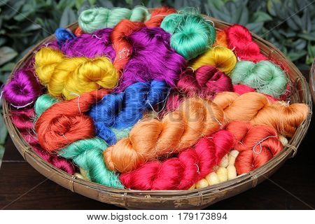 Travel To Bangkok, Thailand. Colorful Threads Of Thai Silk In A Basket Closeup For Background.
