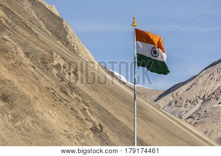 India symbol indian flag against mountains and blue sky