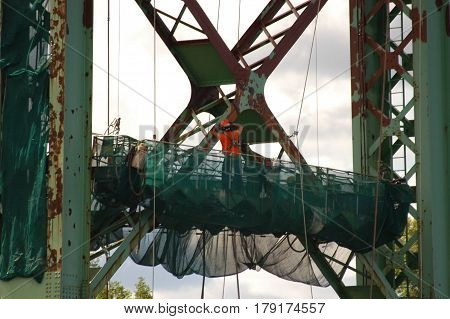 steel bridge green  work  lift  fix  truss