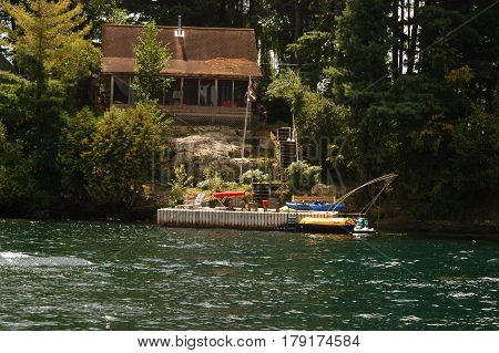 house  boat dock trees water sea way